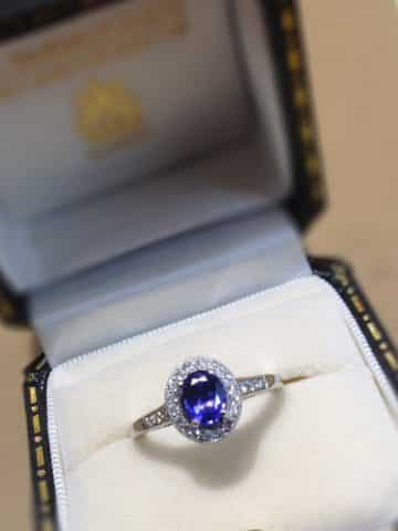 A tanzanite and diamond platinum ring set with a 0.83ct oval tanzanite and 0.83ct brilliant cut diamonds. £3100.